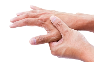 Person rubbing arthritic hands