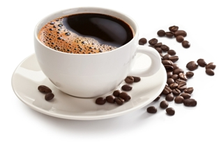 Cup of coffee surrounded by coffee beans