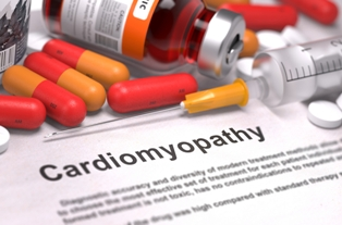 Medications and paper with cardiomyopathy printed on it