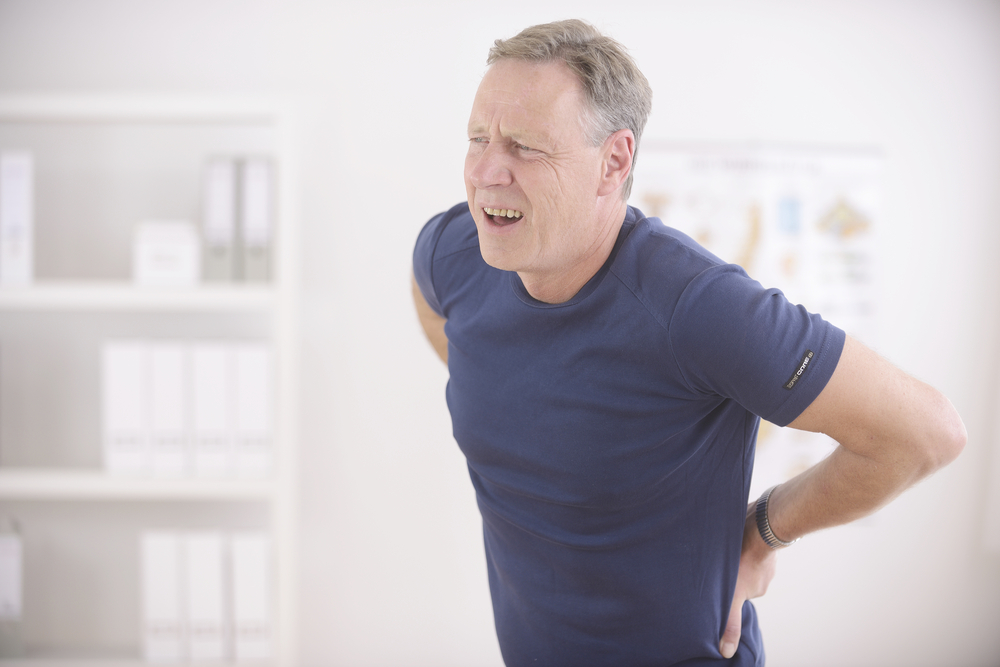 Man suffering with back pain