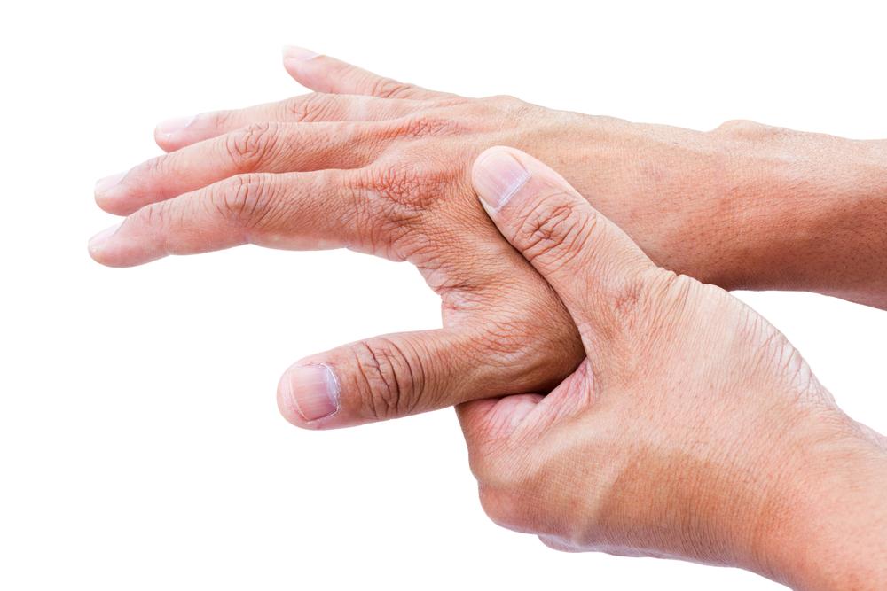 Person rubbing arthritic hands