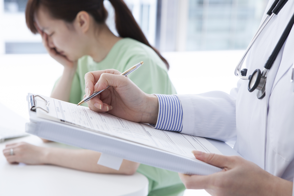 Doctor reviewing medical chart