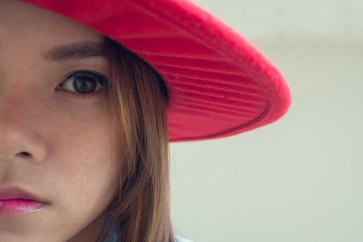 Young girl in red hat