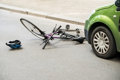 Bicycle on the Ground in Front of a Car After an Accident