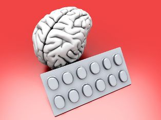 Image of a White Brain With a Bubble Pack of Pills