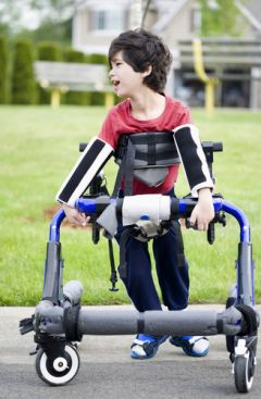 A Young Child With Cerebral Palsy Using a Walker
