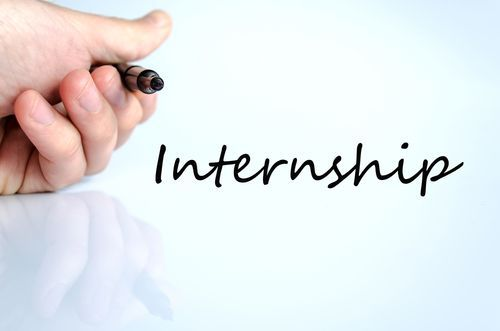 A Hand Writing the Word Internship