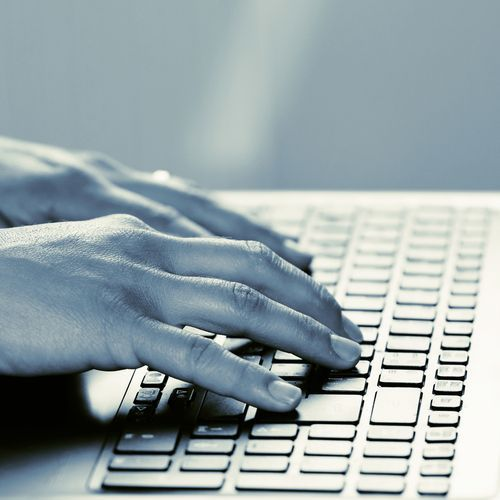 Fingers Resting on a Keyboard