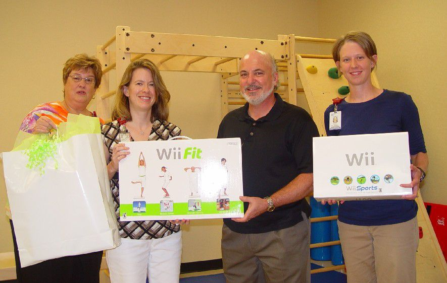 Steve donating a Wii to the Rehab Center