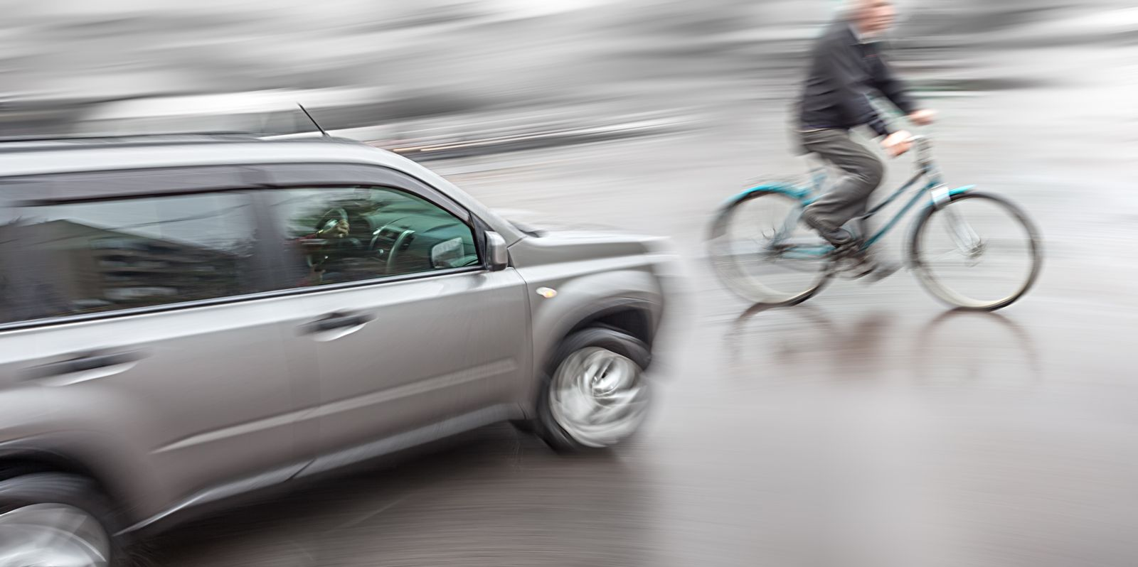 Bicyclist Riding in Front of Car