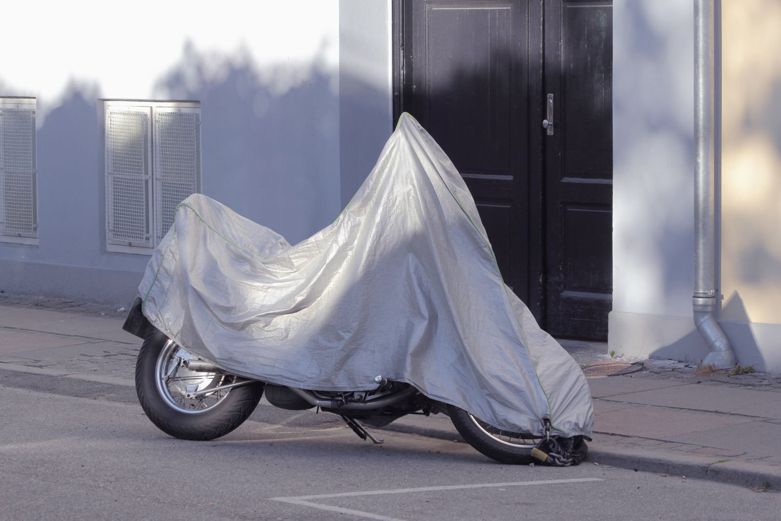 Motorcycle With Cover Parked on Street
