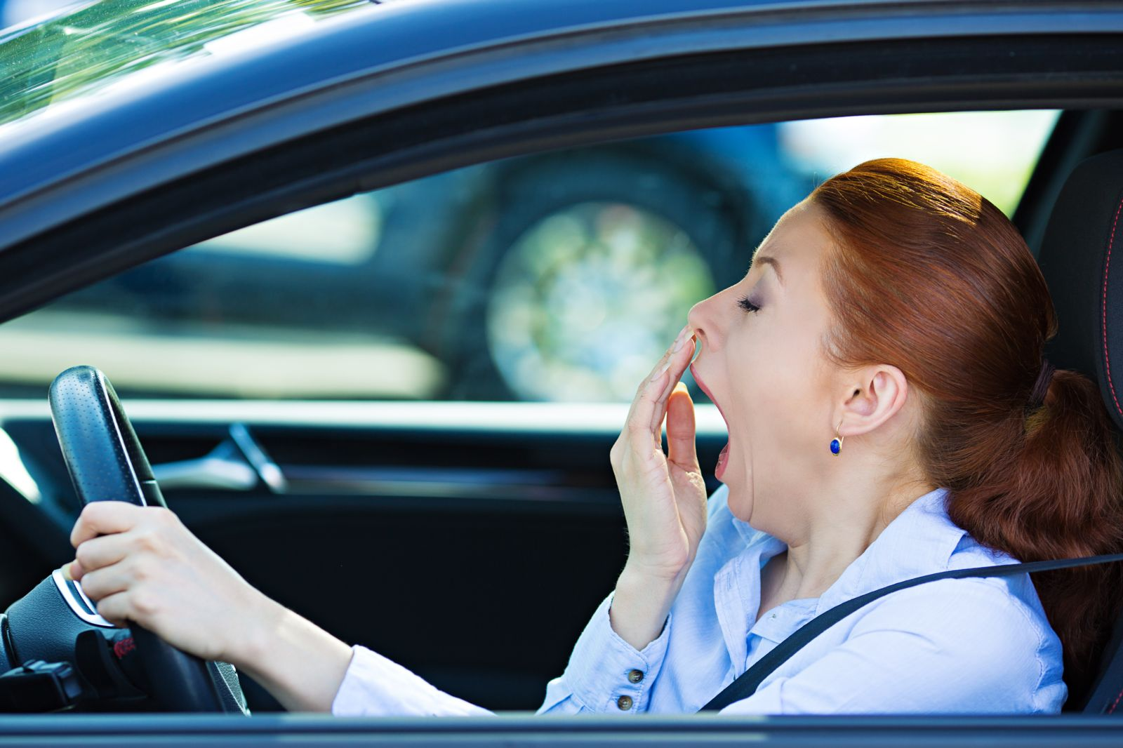 Woman Yawning While Driving