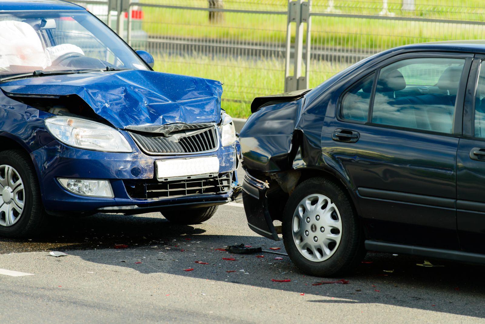 Rear end multiple car crash on street.
