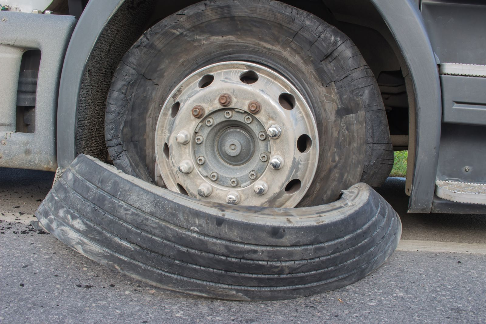 Semi-truck tire blowout causes an accident.