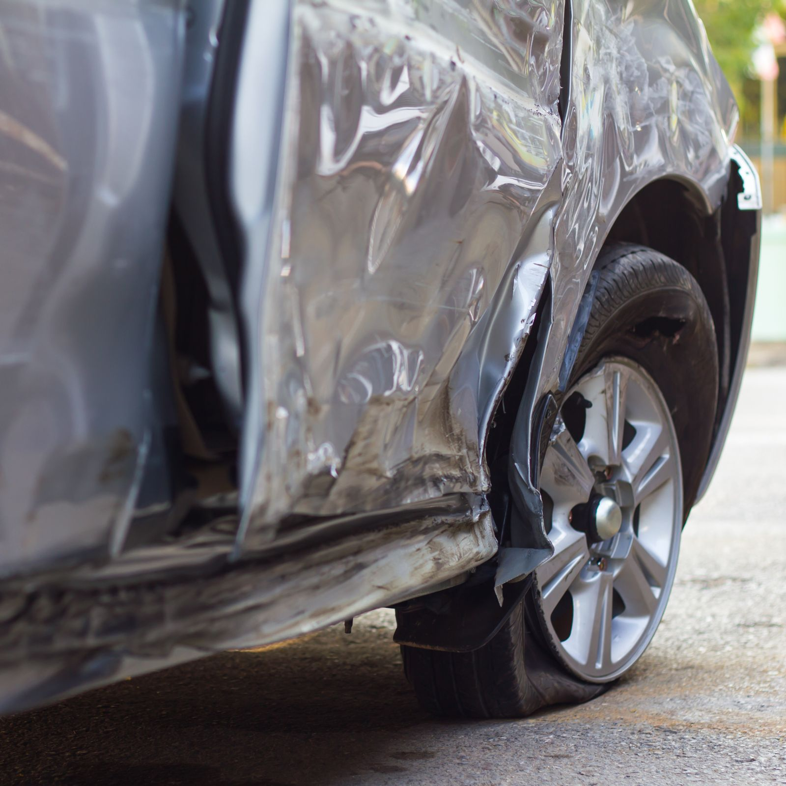 Tire blowout causes car accident and damage.