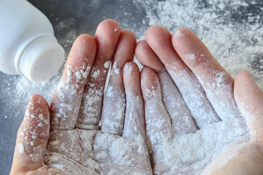 talc powder on hands