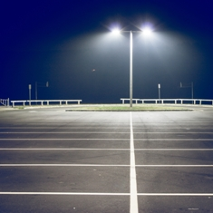 Well-lit parking lot at night