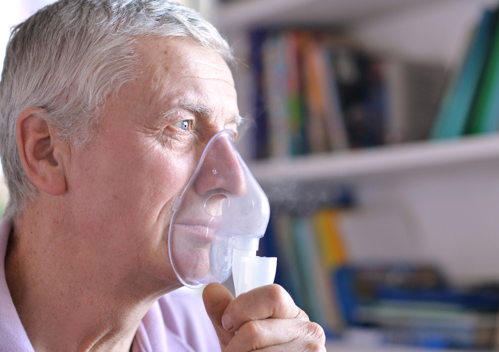 Older man wearing oxygen mask