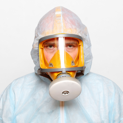 Man in chemical protective suit