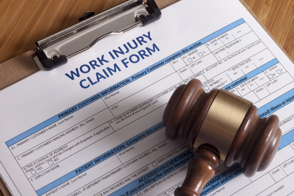 work injury claim form and gavel