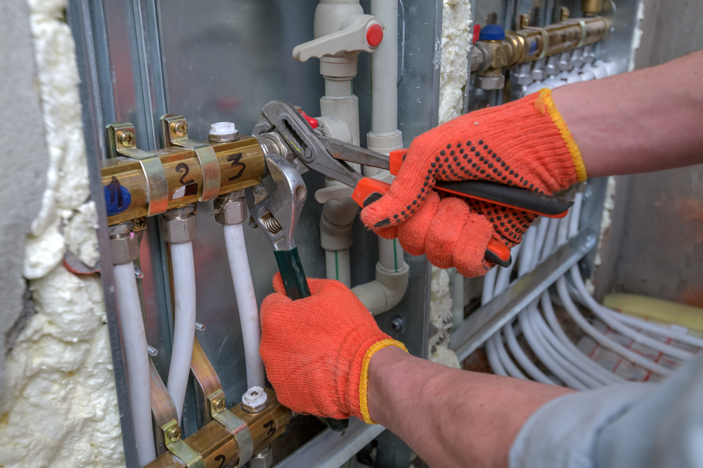 Close-up of pipefitter tightening a pipe