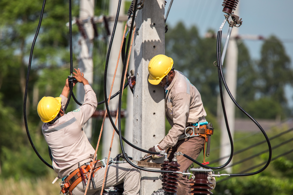 Utility workers working on power lines