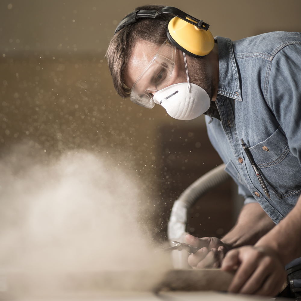 Carpenter working with dust mask