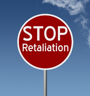 Stop sign with blue sky background: stop retaliation