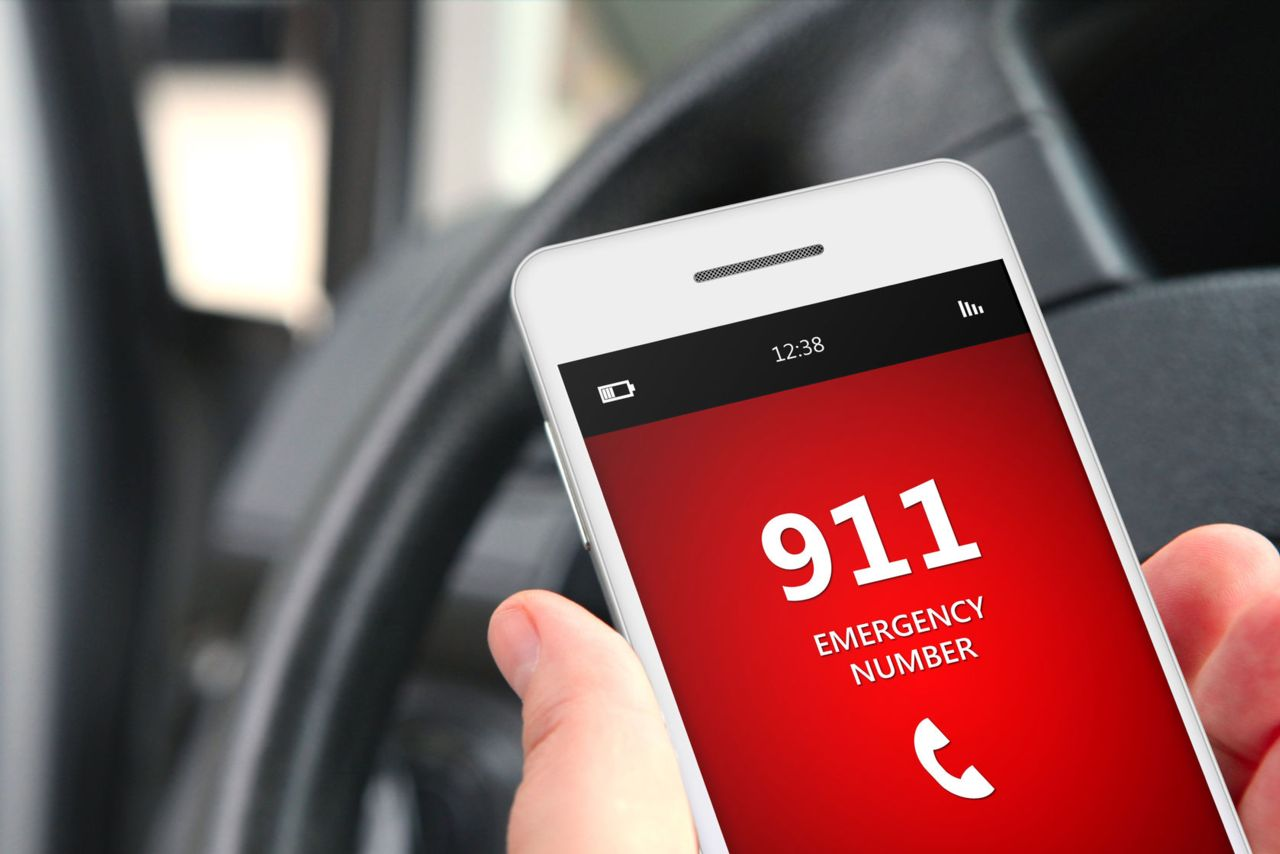 Phone dialing 911 during car accident