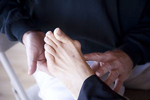 Podiatrist holding patient's foot with bunion