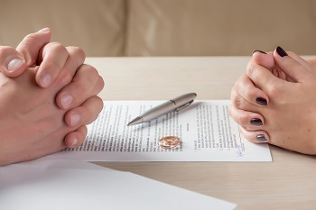 Couple signing prenuptial agreements
