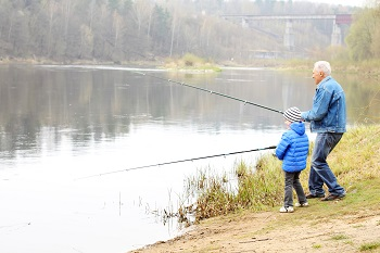Grandparents taking grandchildren fishing