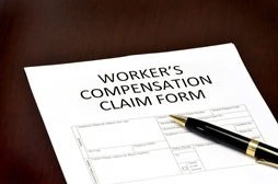 Workers' Compensation Claim Form With Pen