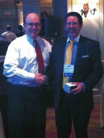 Bill Sherwood, President of the Houston Chapter, NBTA (left) with John Driskill, after speaking at the seminar.