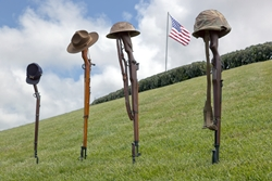 Military rifles and helmets from different wars