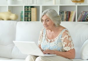 Older woman checking the status of her disability claim