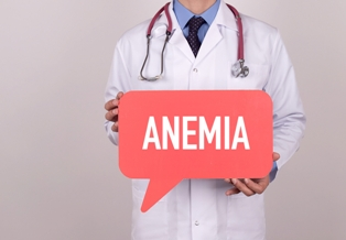 Doctor holding sign that says Anemia