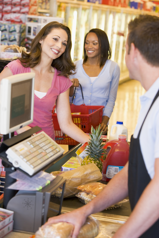 Woman paying for groceries at the checkout