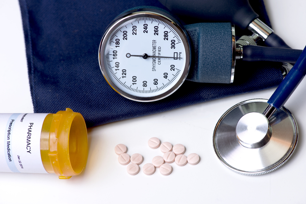 Bottle of pills with blood pressure cuff