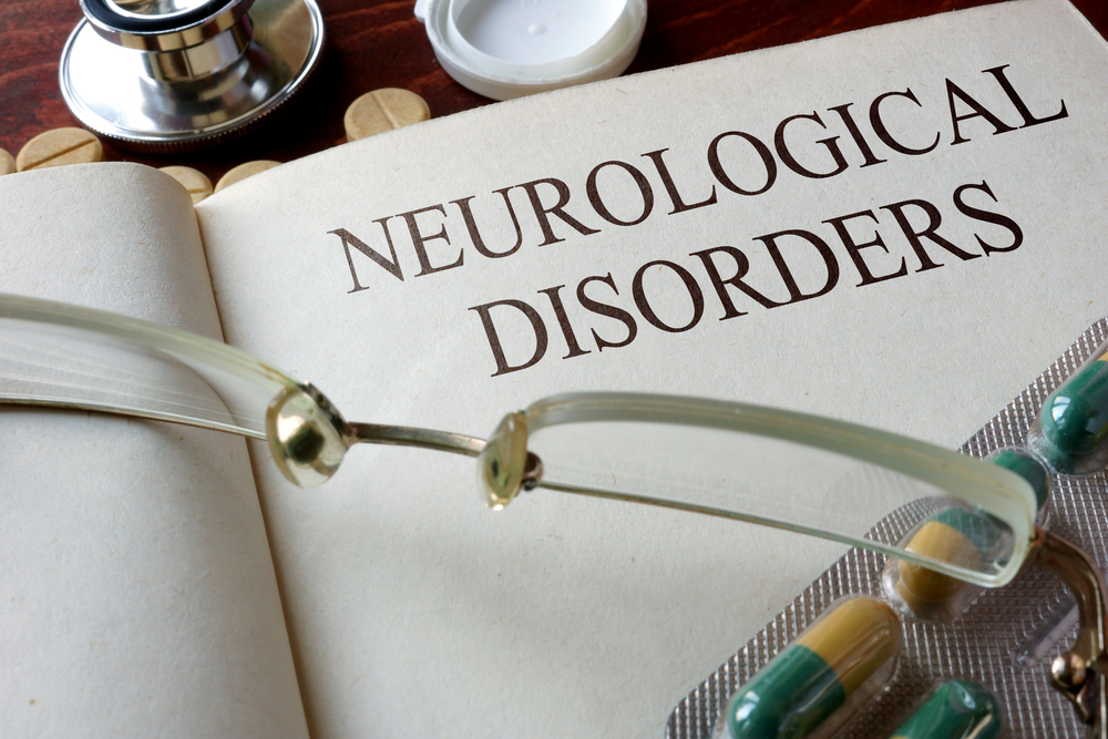 Book of neurological disorders with reading glasses