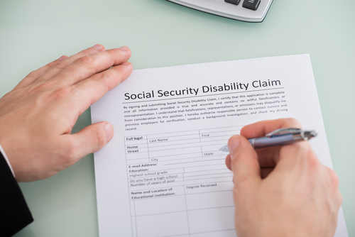 Man filling out SS disability claim