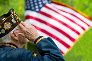 Older veteran saluting the American flag