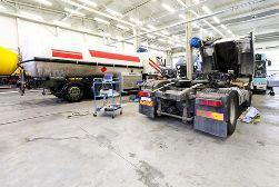 Semi-Truck Cab Receiving Maintenance in a Garage
