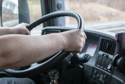 Truck Driver With His Hands on a Steering Wheel
