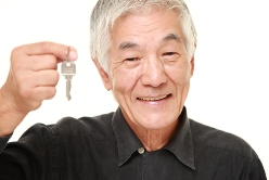 Elderly Driver Holding Keys