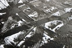 Tire Tracks in an Icy Parking Lot