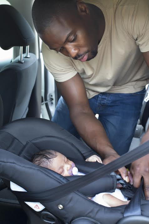 father with car seat