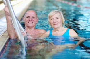 Couple Swimming For Therapy