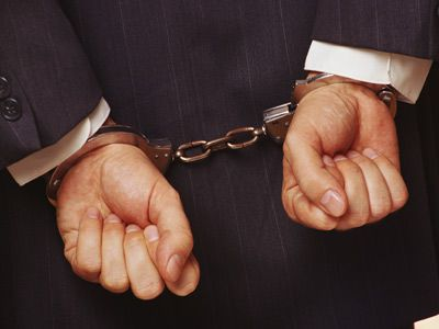 White collar client handcuffed