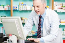 Pharmacist Working on a Computer